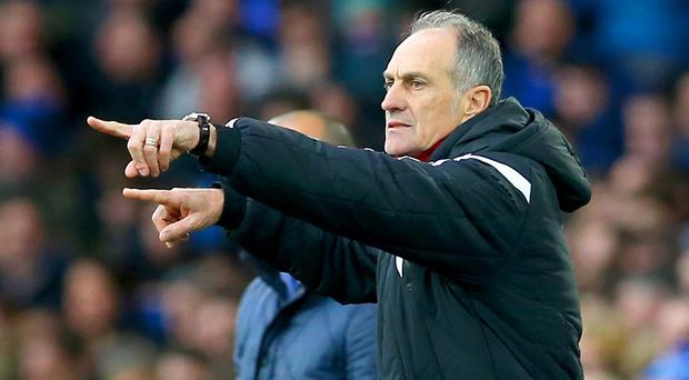 Swansea head coach Francesco Guidolin is set for a reunion with his former Monaco striker Emmanuel Adebayor in their home game with Crystal Palace