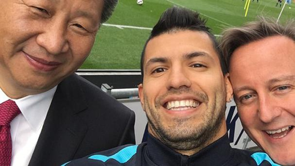 Sergio Aguero, pictured with Chinese president Xi Jinping, will be heading to China with Man City next summer