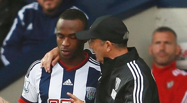Saido Berahino, left, is desperate to play for West Brom, according to manager Tony Pulis, right