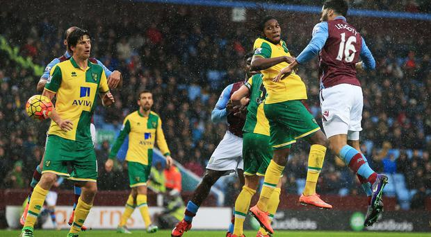Joleon Lescott, far right, heads in Aston Villa's opener in their 2-0 Barclays Premier League win over Norwich