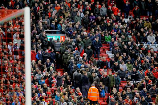 Liverpool supporters make their point at Anfield on Saturday. Photo: PA