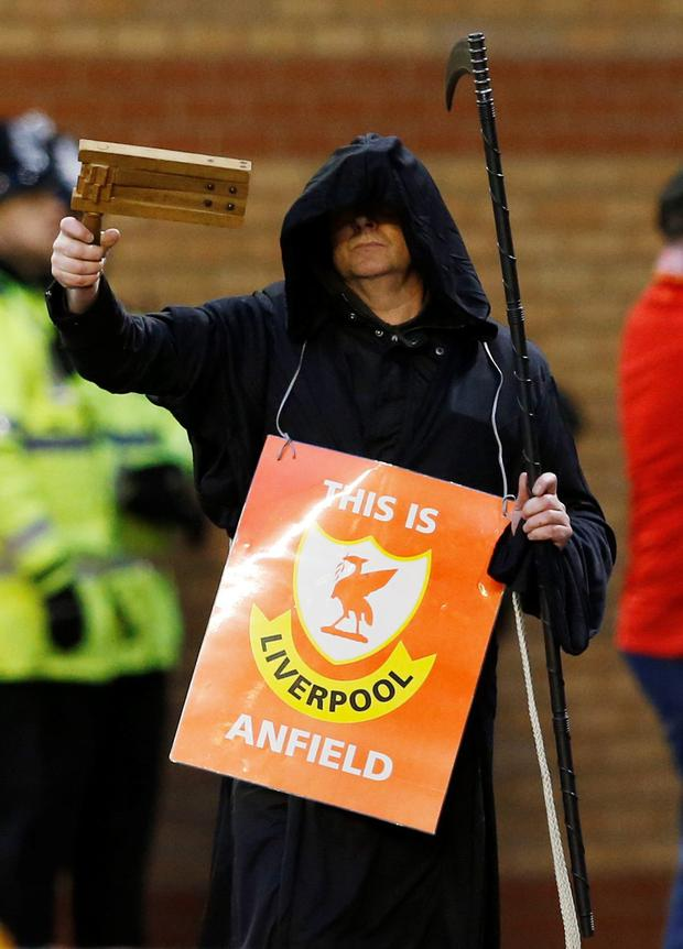 Liverpool fan protesting. Photo: Reuters