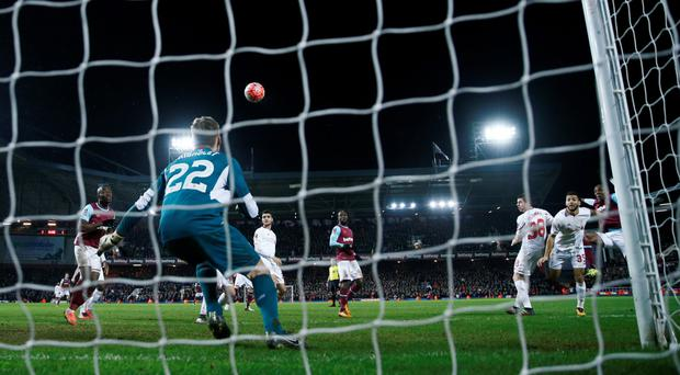 Angelo Ogbonna heads home the winner for West Ham at Upton Park. Photo: Reuters