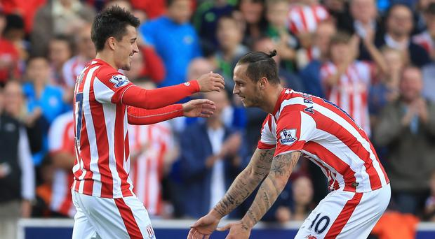 Stoke are hopeful Marko Arnautovic, right, will follow Bojan by signing a new deal