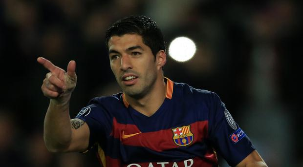 Barcelona's Luis Suarez has not ruled out a return to Liverpool.