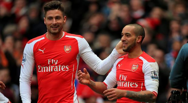 Theo Walcott, right, and Olivier Giroud are competing to start against Leicester