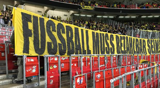 A Dortmund banner which translates as 'football has to be affordable'. Photo: PA