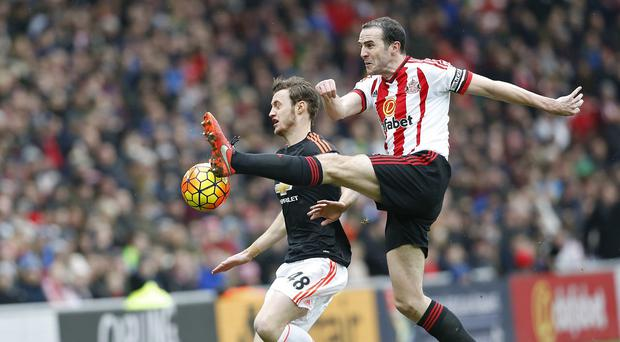 Sunderland defender John O'Shea (right) is expecting no favours in the battle for Barclays Premier League survival