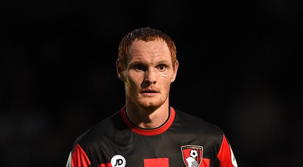 Shaun MacDonald has extended his contract at Bournemouth