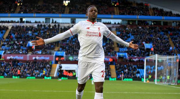 Divock Origi celebrates Liverpool's fourth goal in the 6-0 rout of Aston Villa on Sunday