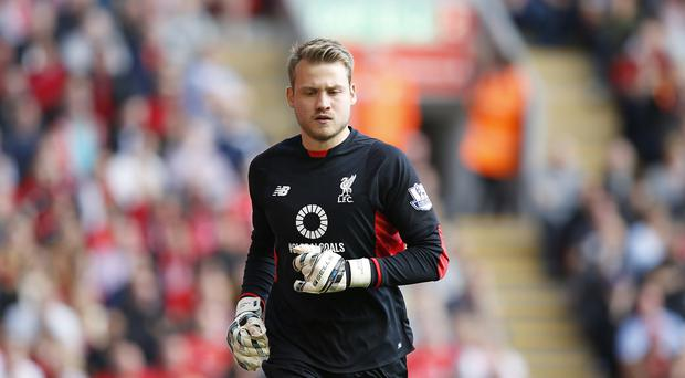 Liverpool goalkeeper Simon Mignolet is confident they can cope with two huge games inside four days