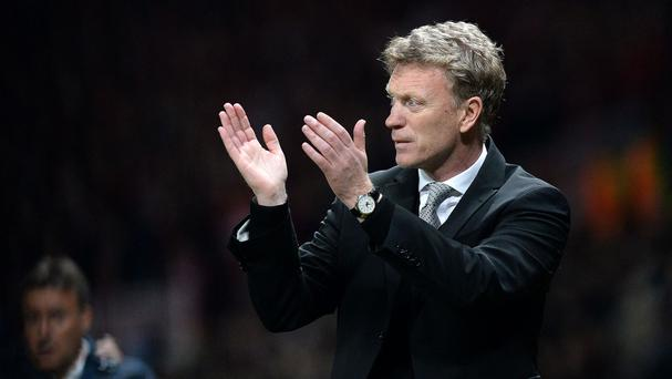 Former Manchester United boss David Moyes, pictured, thinks Louis van Gaal should continue in the job