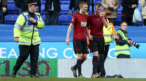 Midfielder Chris Brunt, right, appeared to be struck as he approached his own club's fans on Saturday