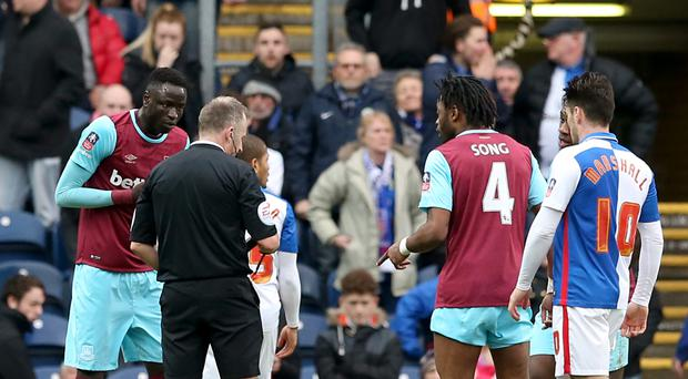 Referee Jon Moss showed Cheikhou Kouyate, pictured left, a straight red card at Blackburn