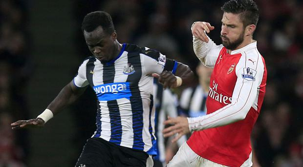 Cheick Tiote, left, looks likely to remain at Newcastle