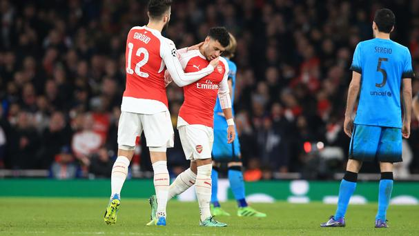 Alex Oxlade-Chamberlain, centre, was injured against Barcelona on Tuesday