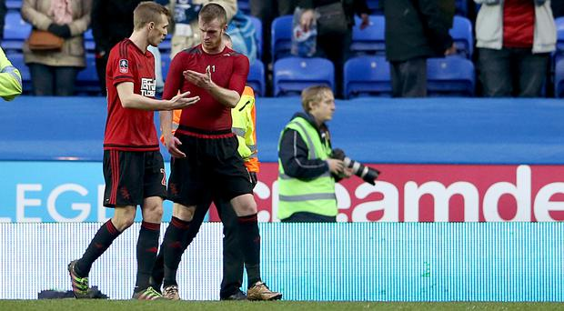 West Brom's Chris Brunt, right, was hit by a coin following Albion's FA Cup defeat to Reading
