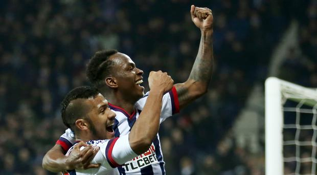 West Brom's Saido Berahino, right, celebrates scoring his side's third goal against Crystal Palace