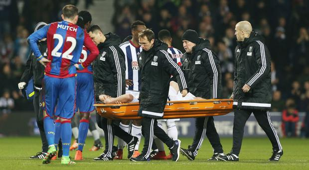 Chris Brunt was carried off on a stretcher after suffering a knee injury
