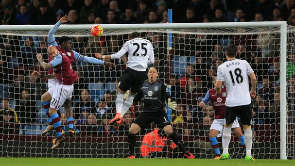 Everton's Ramiro Funes Mori, centre, scores the first goal against Aston Villa