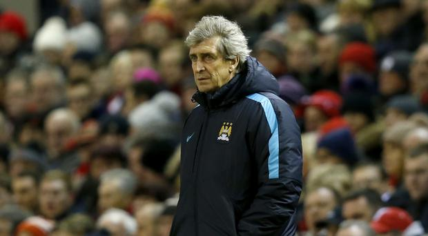 Manchester City manager Manuel Pellegrini's views on the title race have not changed despite a 3-0 defeat at Liverpool