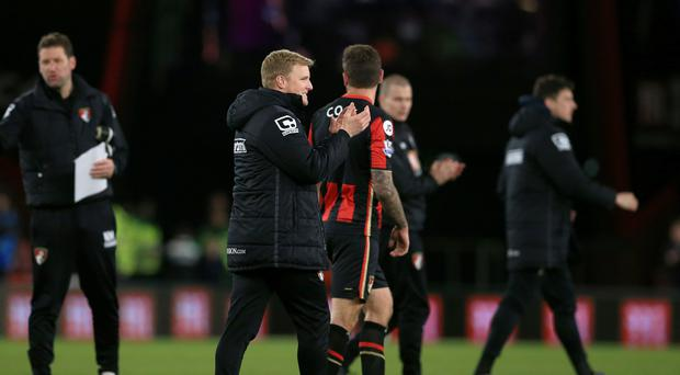 Bournemouth manager Eddie Howe (centre) wants his team to stay focused as they close in on Barclays Premier League survival
