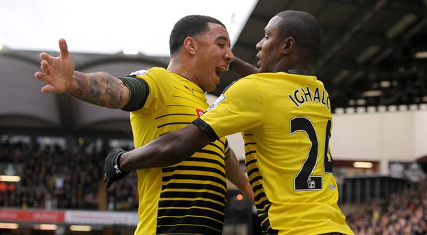 Quique Sanchez Flores expects Troy Deeney, left, and Odion Ighalo to rediscover their goalscoring touch