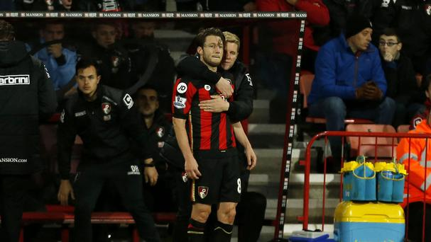 Harry Arter, left, is embraced by Bournemouth boss Eddie Howe