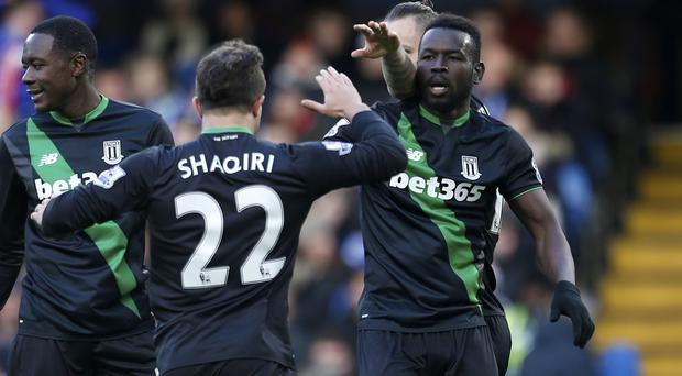 Stoke's Mame Biram Diouf (right) celebrates his equaliser at Chelsea