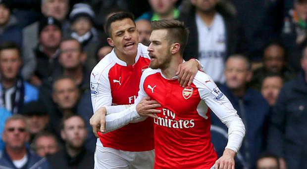 Aaron Ramsey (right) has been linked with a move to Manchester United