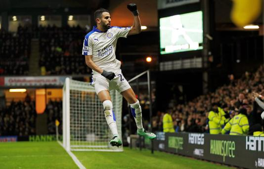 Riyad Mahrez celebrates for Leicester last season