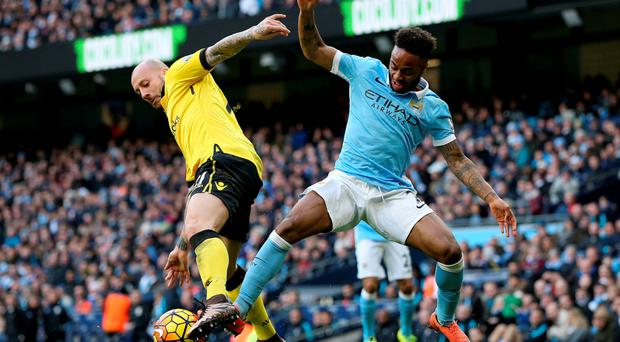 Aston Villa's Alan Hutton and Manchester City's Raheem Sterling battle for the ball during the Barclays Premier League match at the Etihad Stadium. Photo: Martin Rickett