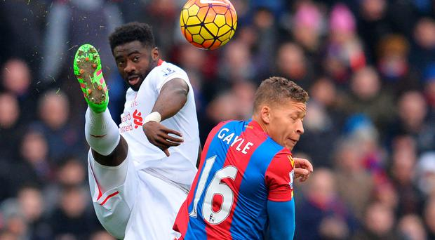 Dwight Gayle turns away as Kolo Toure clears the ball at Selhurst Park Photo: AFP/Getty Images