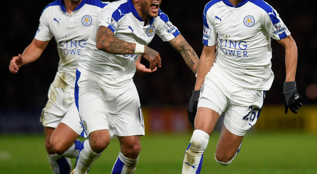 Riyad Mahrez celebrates with team mates after scoring the first goal for Leicester Photo: Getty