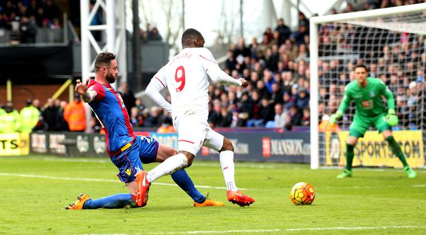 Damien Delaney's challenge on Christian Benteke gave Liverpool a decisive late penalty