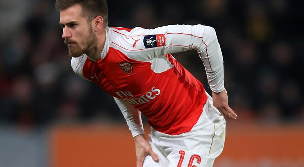 Arsenal are still waiting for news on Aaron Ramsey's thigh injury