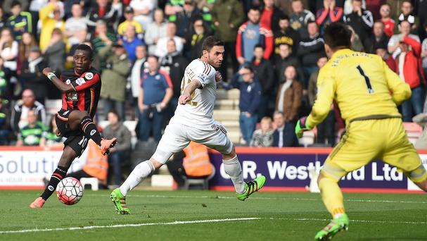 Max Gradel, left, scores Bournemouth's opener against Swansea