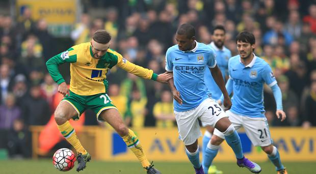 Relegation-battlers Norwich dented Manchester City's Barclays Premier League title hopes as they fought out a goalless draw at Carrow Road