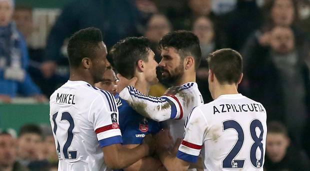 Gareth Barry was shown his first yellow card following this altercation with Diego Costa that earned the Chelsea man a red