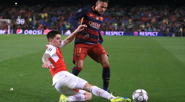 Arsenal's Hector Bellerin, pictured left, is looking on the bright side after Arsenal's defeat in Barcelona