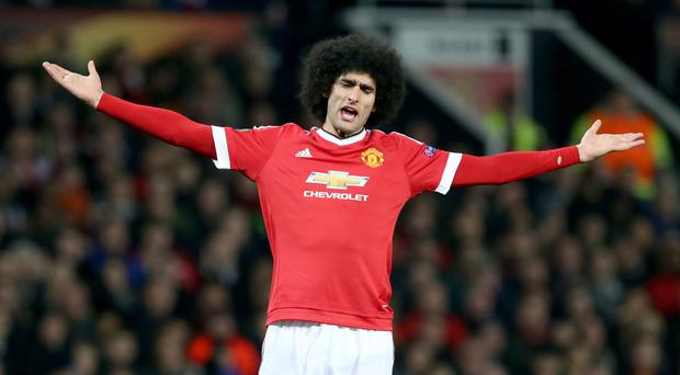 Manchester United's Marouane Fellaini, pictured, was branded a 'thug' by Howard Webb