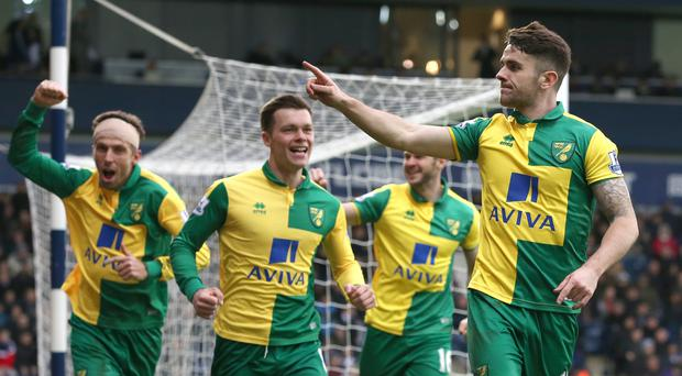 Norwich's Robbie Brady (right) celebrates his opener against West Brom at The Hawthorns.