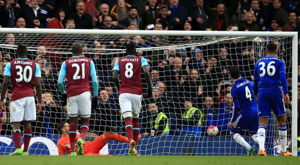Cesc Fabregas, second from right, tucks home the equaliser from the penalty spot