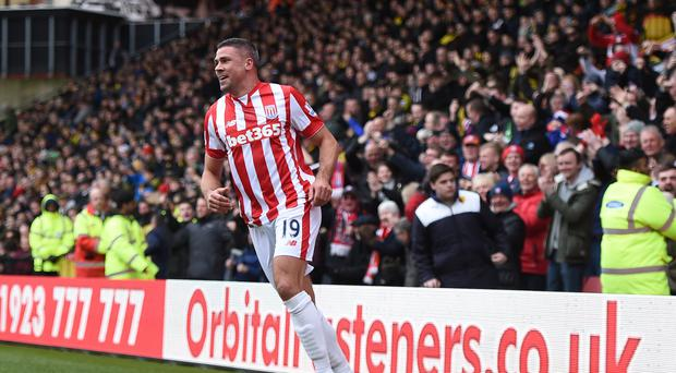 Stoke's Jonathan Walters celebrates scoring his side's first goal against Watford at Vicarage Road