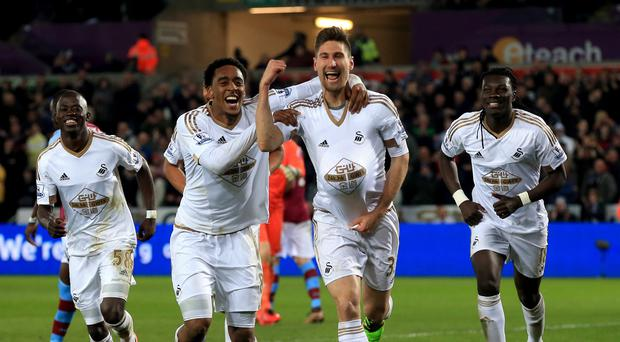 Swansea's Federico Fernandez, centre, celebrates scoring his side's winner in their 1-0 victory over Aston Villa.