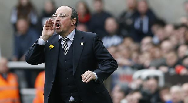 Newcastle manager Rafael Benitez has warned his players they face a fight to the death to preserve their Barclays Premier League status