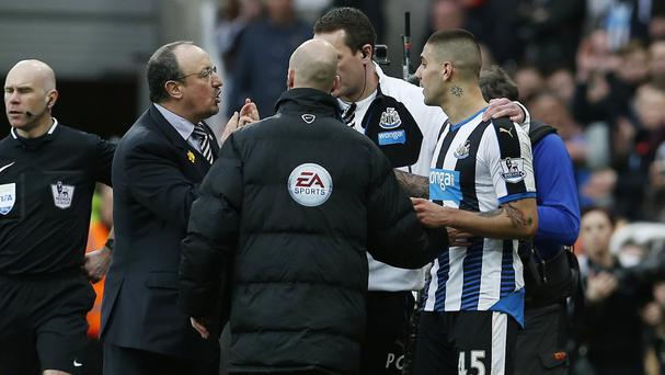 Rafael Benitez, left, stops Aleksandar Mitrovic, right, from returning to the pitch after suffering a head injury
