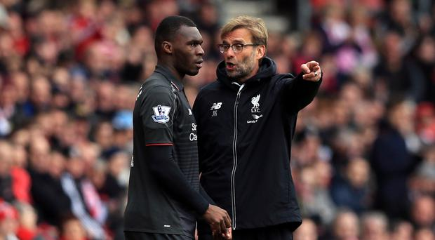 Christian Benteke, left, cannot understand why Liverpool boss Jurgen Klopp does not play him