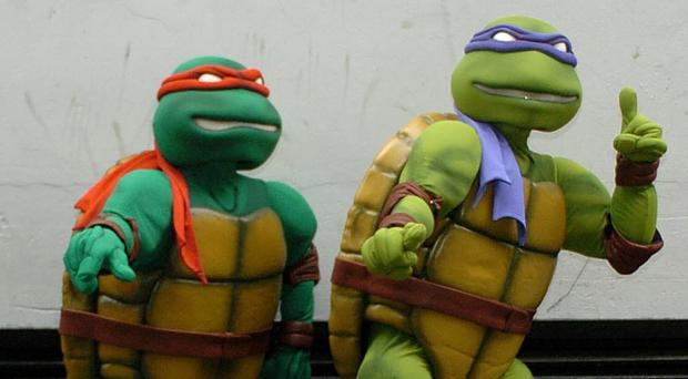 Danny Drinkwater dressed up as Teenage Mutant Ninja Turtle Raphael, left, for Leicester's Christmas party