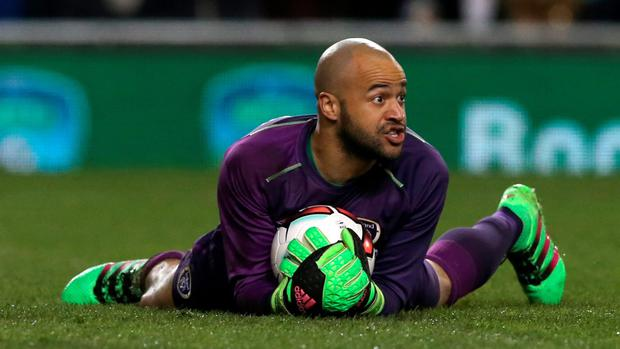 Darren Randolph smothers the ball safely during last night's friendly against Slovakia after coming on as a first-half substitute for the injured Rob Elliot.